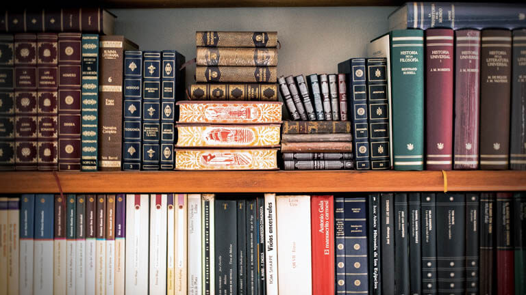 Image of books on a shelf that illustrates ASR Law Firm Florida business law services including trademark and intellectual property protection.