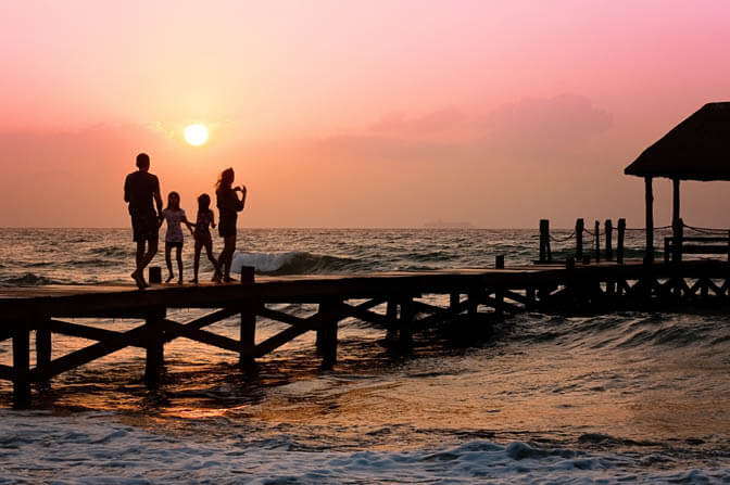Image of a family at the beach at sunset that links to the comprehensive Estate Planning Law Services from Boca Raton Law Firm, ASR Law Firm.