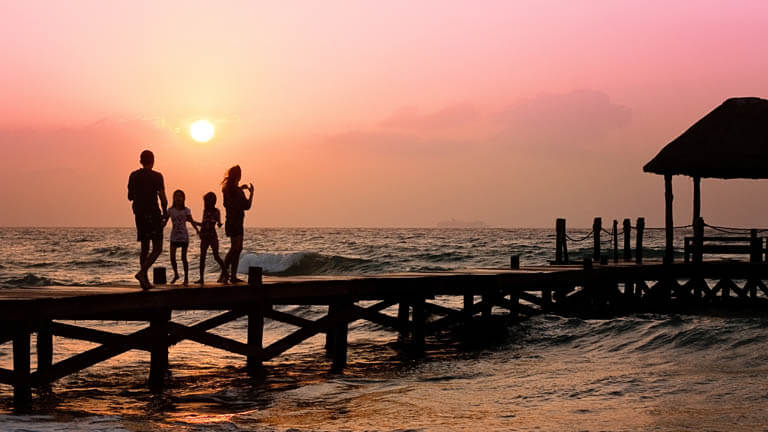 Image of a family on a dock that illustrates Boca Raton estate planning that links to the Estate Planning Law Practice Areas at ASR Law Firm.