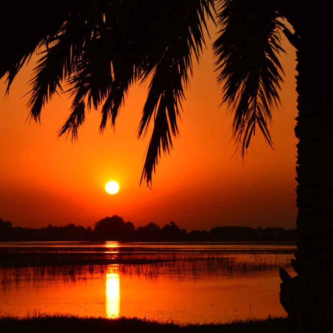 Image of Boca Raton sunset over the everglades and south florida real estate.