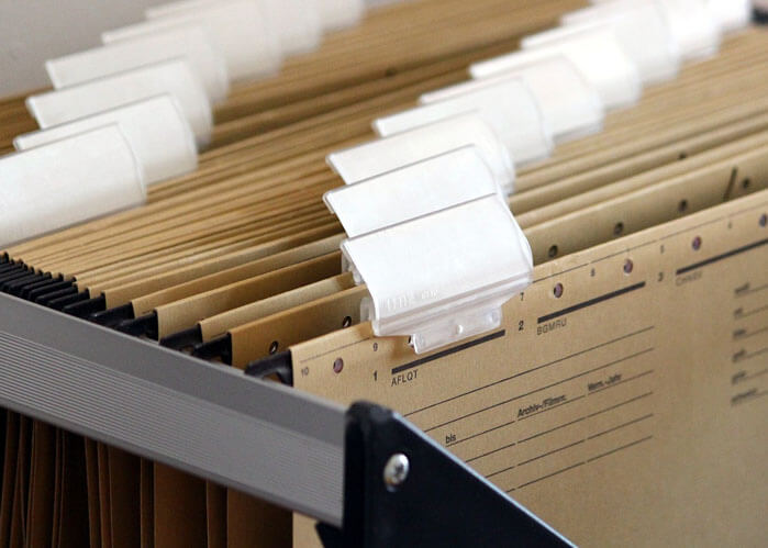 An image of a filing system that serves as the featured image of what is a title search in Florida.