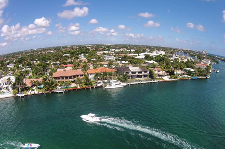 An image of South Florida waterfront real estate, used as the featured image of why use ASR Law Firm Title Services.