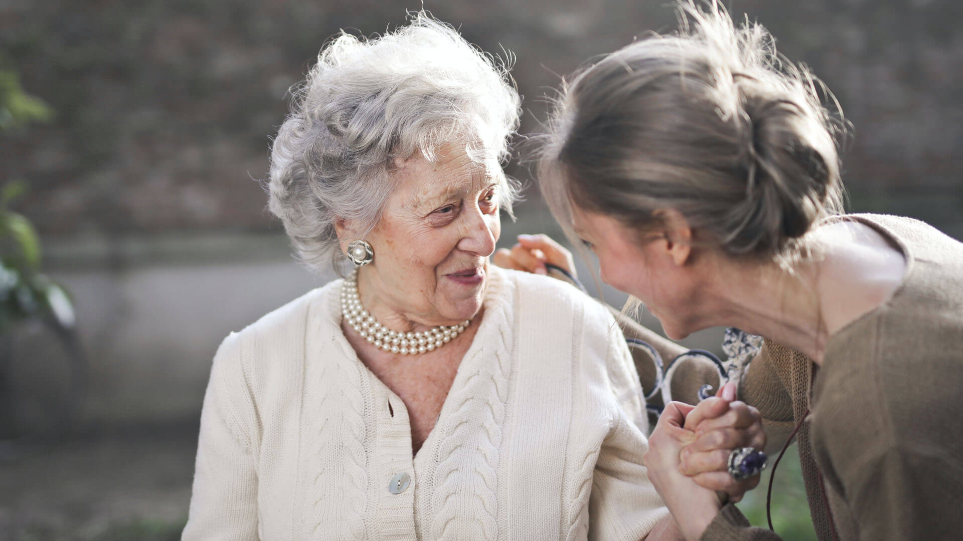 An image of an elderly woman chatting with her daughter that serves as the featured image for the Florida Lady Bird Deed from ASR Law Firm.