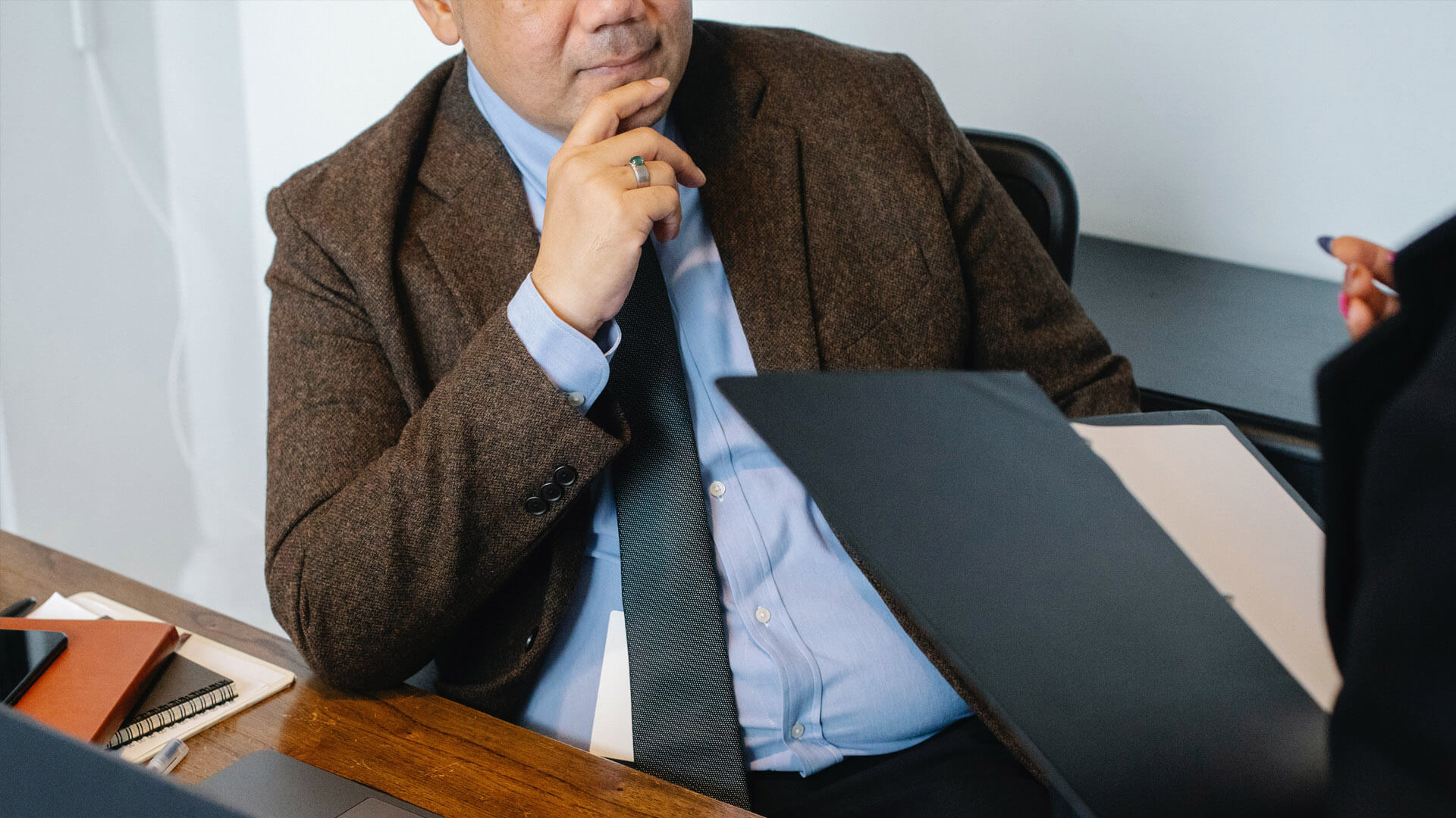 An image of a business man discussing estate planning for small business owners with an estate planning attorney.