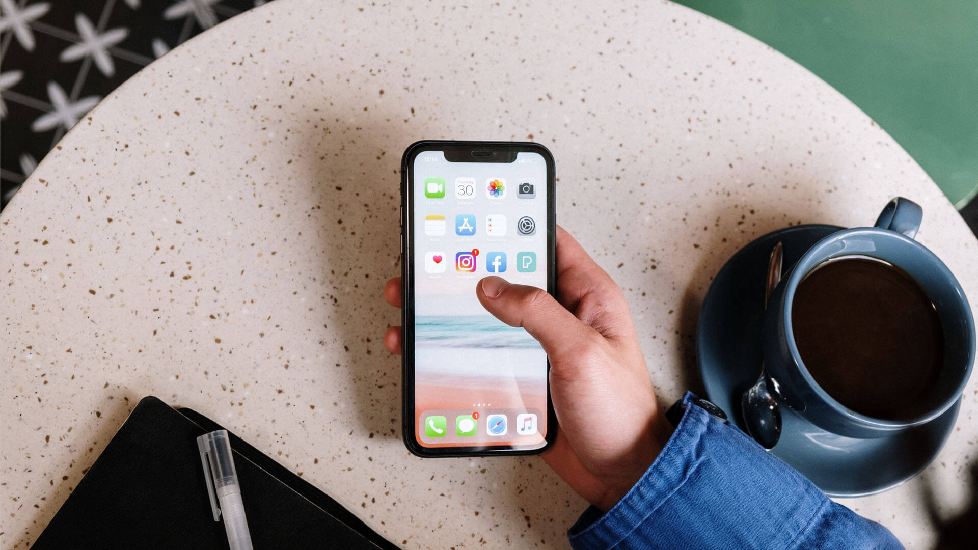 An image of a person on a smart phone going to social media that is the primary featured photo for the article Trademark Protection & Social Media: 3 Important Considerations for business owners.