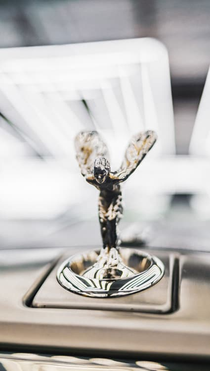 An image of a Rolls Royce emblem that illustrates the need to protect a brand with trademark application.
